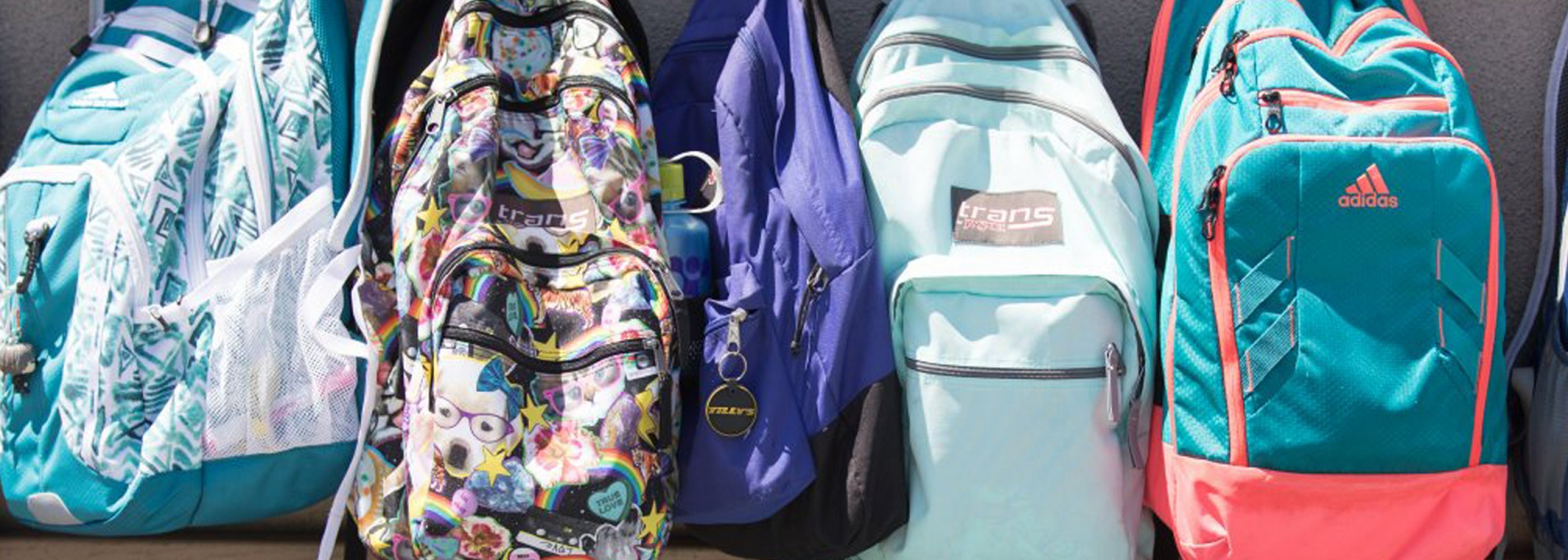 lined up backpacks